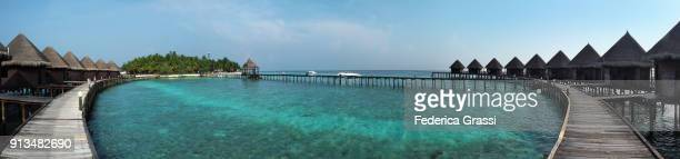 Panoramic with Elevated Walkway And Overwater Bungalows On Maldivian Island