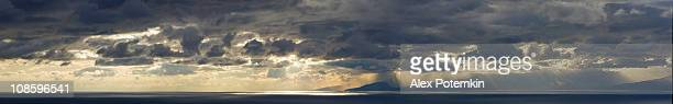 panoramic xxxl sunset over ocean, with dramatic sky and rain - cloudy sky stock pictures, royalty-free photos & images