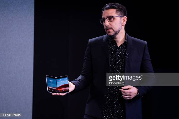 Panos Panay, chief product officer of Microsoft Corp., displays the Surface Duo smartphone during a Microsoft product event in New York, U.S., on...