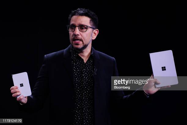 Panos Panay, chief product officer of Microsoft Corp., displays the Surface Duo phone, left, and Surface Neo, during a Microsoft product event in New...
