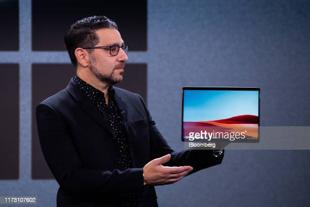 ]Panos Panay chief product officer of Microsoft Corp displays the Surface Pro X hybrid tablet and laptop computer during a Microsoft product event in...