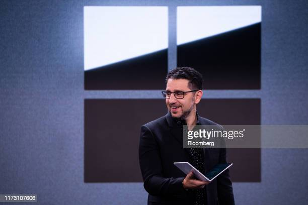 Panos Panay, chief product officer of Microsoft Corp., holds the Surface Neo laptop computer during a Microsoft product event in New York, U.S., on...