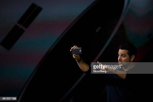Panos Panay, corporate vice president of Microsoft Corp. Surface, displays the new Microsoft Lumia smartphone during the Windows 10 Devices event in...
