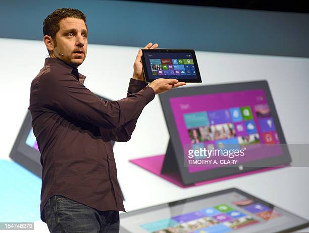 Panos Panay the general manager of the Microsoft Surface holds up a Surface tablet during a press conference at Pier 57 to officially launch Windows...