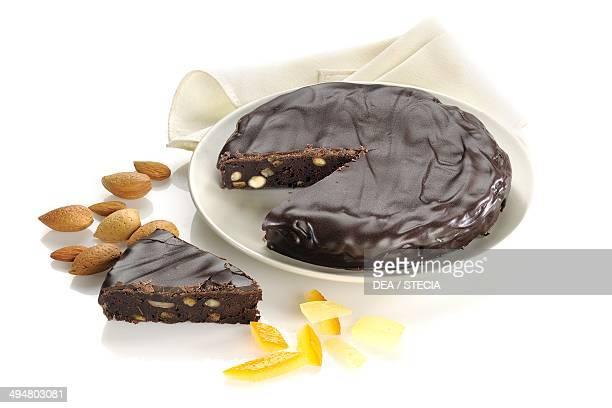 Panpepato from Ferrara spicy chocolate cake with almonds hazelnuts pine nuts pepper cinnamon walnut Emilia Romagna Italy