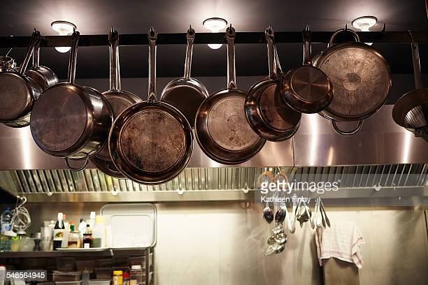 pans hanging in commercial kitchen - saucepan stock pictures, royalty-free photos & images