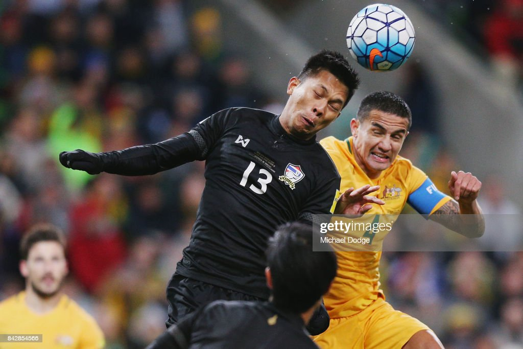 Pansa Hemviboon of Thailand heads the ball away from Tim Cahill of the Socceroos during the 2018 FIFA World Cup Qualifier match between the Australian Socceroos and Thailand at AAMI Park on September 5, 2017 in Melbourne, Australia.