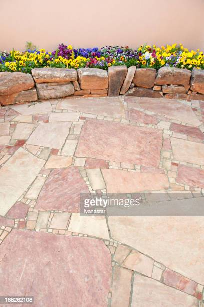 Pansy Flowers in Rock Garden with Flagstone Paving Stone