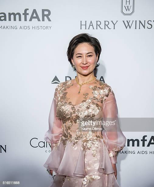 Pansy Ho attends the 2016 amfAR Hong Kong gala with a guest at Shaw Studios on March 19 2016 in Hong Kong Hong Kong