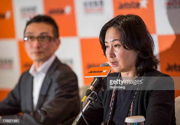 Pansy Ho managing director of Shun Tak Holdings Ltd right speaks while Edward Lau chief executive officer of Jetstar Hong Kong listens during a news...