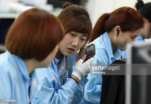 Pantech Co employees work on the production line manufacturing mobile phones at the company's factory in Gimpo South Korea on Thursday April 28 2011...