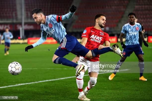 Pantelis Chatzidiakos of AZ Alkmaar tackles Nicolas Tagliafico of Ajax during the KNVB Beker or Dutch Cup match between AZ Alkmaar and AFC Ajax...