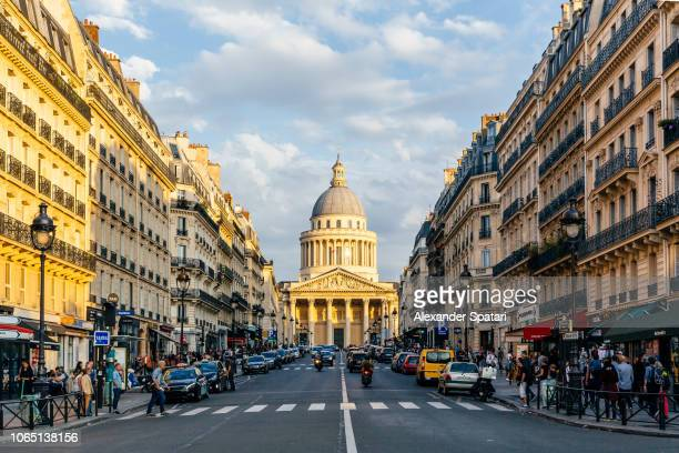 pantheon and street in latin quarter, paris, france - paris stock-fotos und bilder
