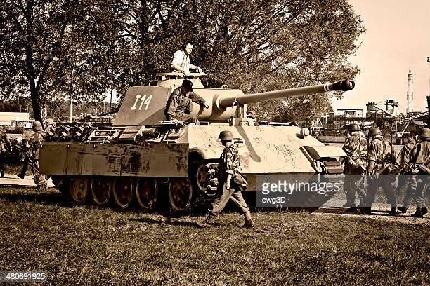 WW II Panther tank and infantry soldiers