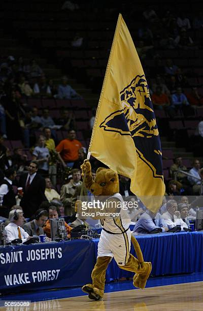 Panther the University of Pittsburgh Panthers mascot carries a flag during the third round game of the NCAA Division I Men's Basketball Tournament...