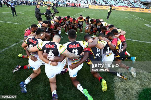 Panthers and Hunters players perform pray after the 2017 State Championship Final between the Penrith Panthers and Papua New Guinea Hunters at ANZ...