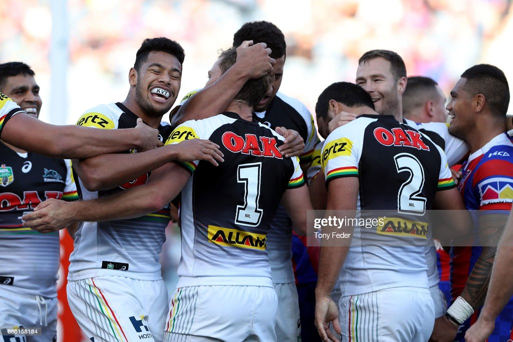 Panthers players celebrate a try during the round 11 NRL match between the Newcastle Knights and the Penrith Panthers at McDonald Jones Stadium on May 21, 2017 in Newcastle, Australia.