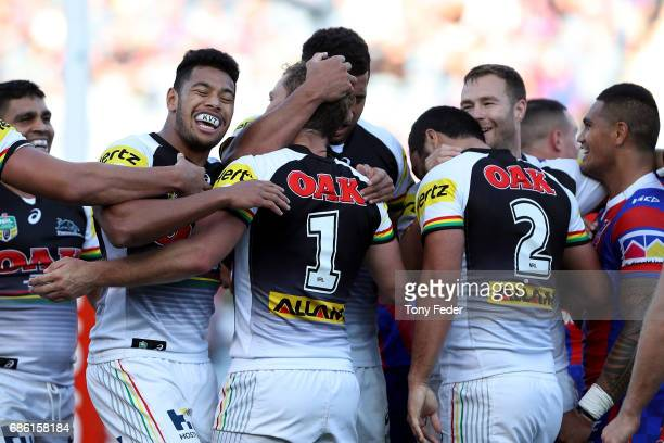 Panthers players celebrate a try during the round 11 NRL match between the Newcastle Knights and the Penrith Panthers at McDonald Jones Stadium on...