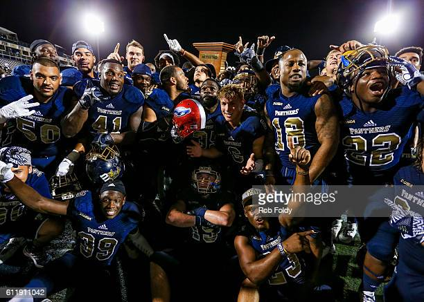 Panthers players celebrate after the game against the Florida Atlantic Owls at FIU Stadium on October 1 2016 in Miami Florida