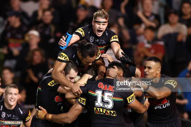 Panthers players celebrate winning the round three NRL match between the Penrith Panthers and the Melbourne Storm at Panthers Stadium on March 25 in...
