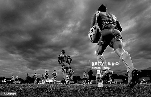 Panthers players run out to the field during the round 17 NRL match between the Gold Coast Titans and the Penrith Panthers at TIO Stadium on July 6...