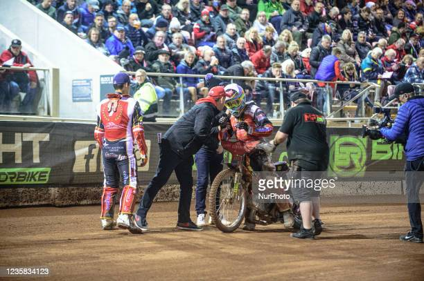 Panthers riders and staff congratulate Michael Palm Toft on his ride during the SGB Premiership Grand Final 1st Leg between Belle Vue Aces and...