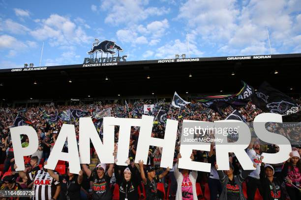 Panthers supporters cheer during the round 19 NRL match between the Panthers and Raiders at Panthers Stadium on July 28, 2019 in Penrith, Australia.