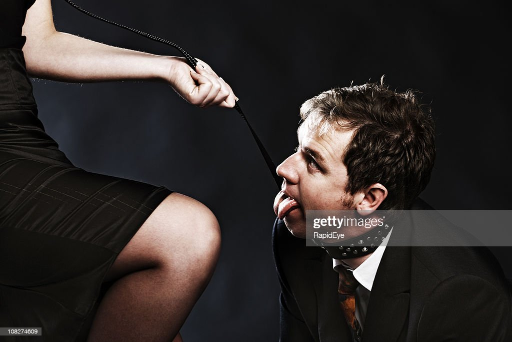 Panting businessman on a leash : Stock Photo