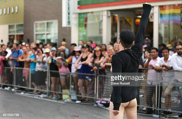 TORONTO ON JUNE 29 Pantless a parader declares that he love his foreskin during the WorldPride 2014 parade hosted by Pride Toronto along Yonge Street...