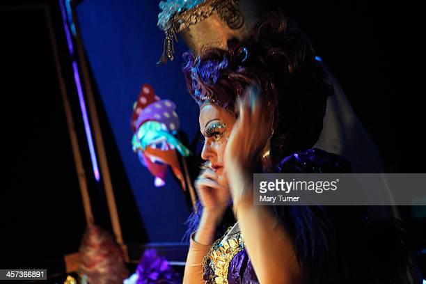 Pantomime Dame Nigel Ellacott adjusts his wig before taking the stage as Queen Bloywyn in Sleeping Beauty at Venue Cymru on December 14 2013 in...