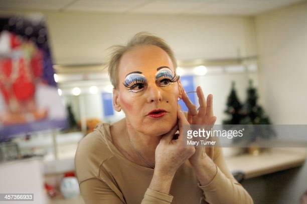 Pantomime Dame Nigel Ellacott attaches a microphone in his dressing room at Venue Cymru Theatre where he is performing as Queen Blodwyn in Sleeping...