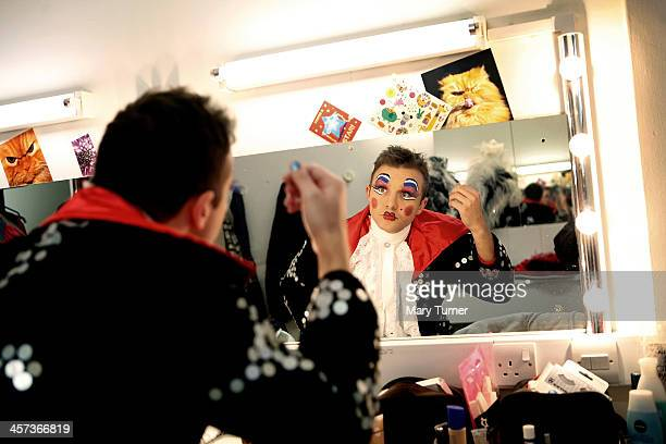 Pantomime Dame Steve Wickenden checks his appearance in his dressing room as he transforms himself into Sarah The Cook at Millfield Arts Centre on...