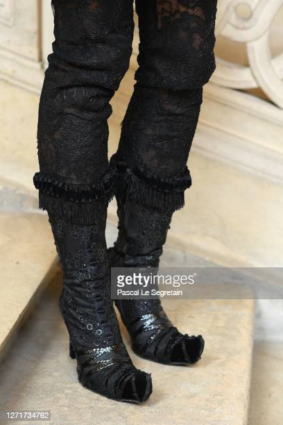 Pants in mosaic lace and embroidered babouche boots are seen at Conservatoire national des arts et metiers on July 26, 2020 in Paris, France.