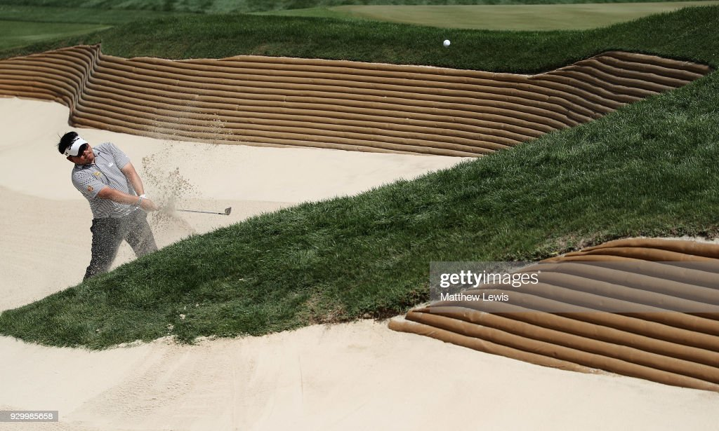 Panuphol Pittayarat of Thailand plays out of a bunker on the 2nd hole during day three of the Hero Indian Open at Dlf Golf and Country Club on March 10, 2018 in New Delhi, India.