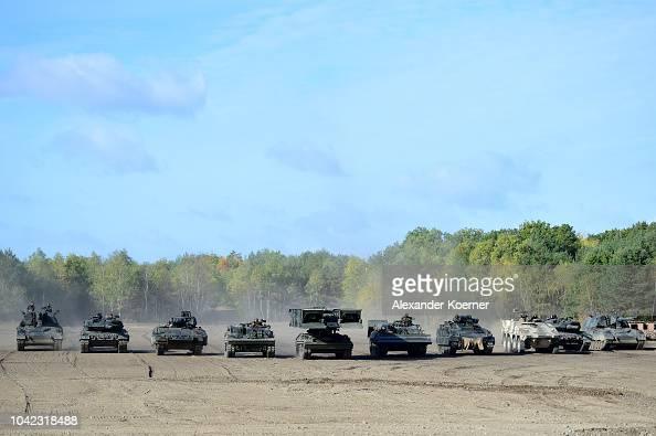 A Panzerhaubitze 2000 tank, a Leopard 2A7 tank, a Puma light