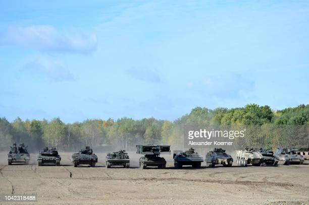 A Panzerhaubitze 2000 tank a Leopard 2A7 tank a Puma light tank a Mammut tank a Biber tank a Dachs tank a Mader tank a Boxxer tank a Leopard 2A7 tank...