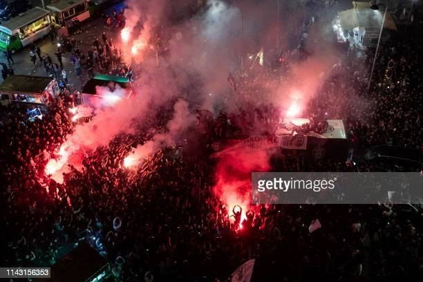 TOPSHOT Paok FC fans burn flares as they celebrate after winning the Greek Cup final football match against AEK Athens in Thessaloniki on May 12 2019...