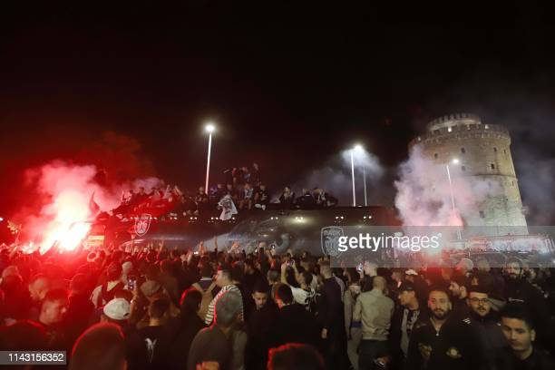 Paok FC fans celebrate after winning the Greek Cup final football match against AEK Athens in front of the White Tower in Thessaloniki on May 12 2019...