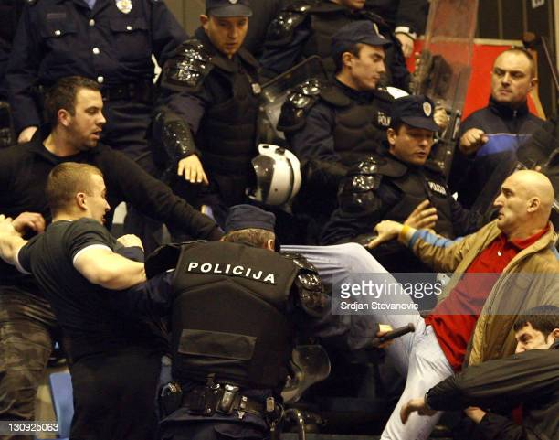 Paok Thessaloniki and Partizan supportes fight against Red Star fans during their group D ULEB Cup basketball match in Belgrade Serbia Tuesday...