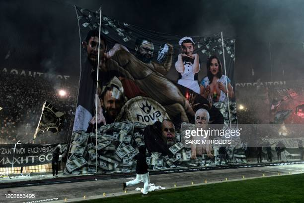 Paok's fans deploy a giant banner during the Greek Superleague football match between PAOK Thessaloniki and Olympiakos Piraeus at the Toumba Stadium...