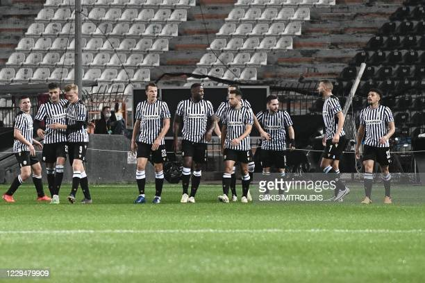 Paok's players celebrate after scoring a goal during the UEFA Europa League Group E football match between Paok and PSV Eindhoven at the Toumba...