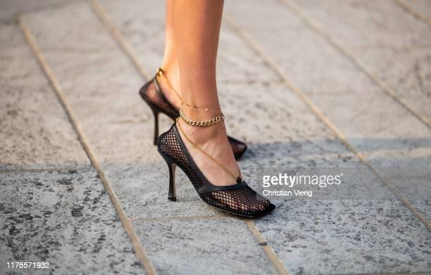 Paola Alberdi is seen wearing Bottega Veneta Mesh Heels outside the Alberta Ferretti show during Milan Fashion Week Spring/Summer 2020 on September...