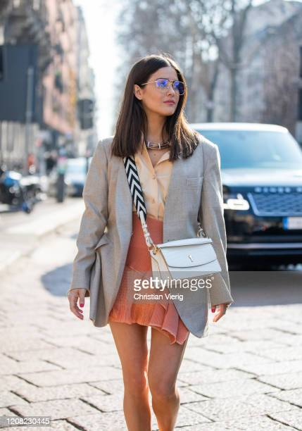 Paola Alberdi is seen wearing camel button shirt, rust brown skirt, white bag outside Bally during Milan Fashion Week Fall/Winter 2020-2021 on...