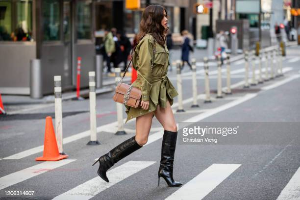 Paola Alberdi is seen wearing olive bag outside Michael Kors during New York Fashion Week Fall / Winter 2020 on February 12, 2020 in New York City.