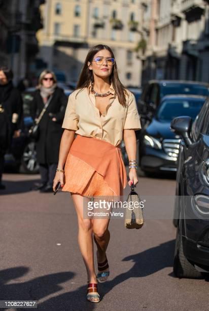 Paola Alberdi is seen wearing rust brown skirt, camel button shirt outside Ferragamo during Milan Fashion Week Fall/Winter 2020-2021 on February 22,...
