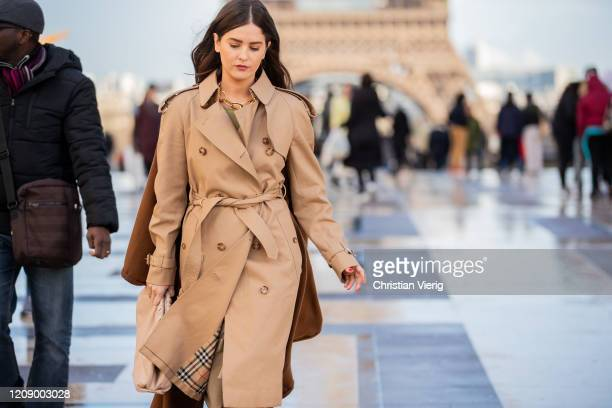 Paola Alberdi is seen wearing trench coat, brown cape, Bottega bag outside Rochas during Paris Fashion Week - Womenswear Fall/Winter 2020/2021 : Day...