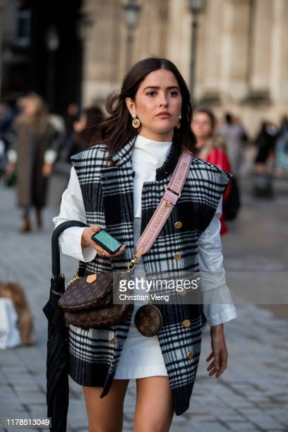 Paola Alberdi seen wearing checkered vest white top and skirt fanny bag outside Louis Vuitton during Paris Fashion Week Womenswear Spring Summer 2020...