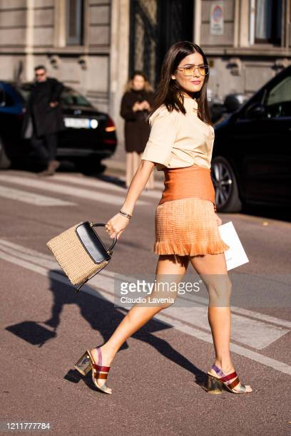 Paola Alberdi, wearing a beige shirt, tan decorated mini skirt, sandals and rattan bag, is seen outside Salvatore Ferragamo show, during Milan...