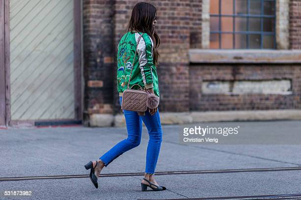 Paola Alberdi wearing a green bomber jacket denim jeans a nude Chanel bag at MercedesBenz Fashion Week Resort 17 Collections at Carriageworks on May...