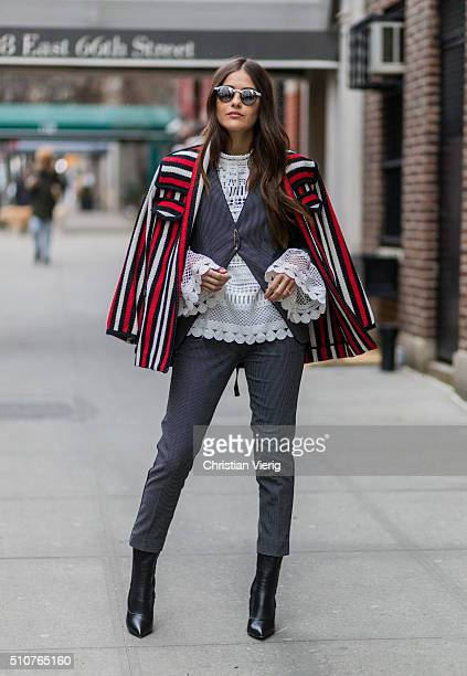 Paola Alberdi wearing a red creme black stripped Tommy Hilfiger jacket and grey pants seen outside Tommy Hilfiger during New York Fashion Week...